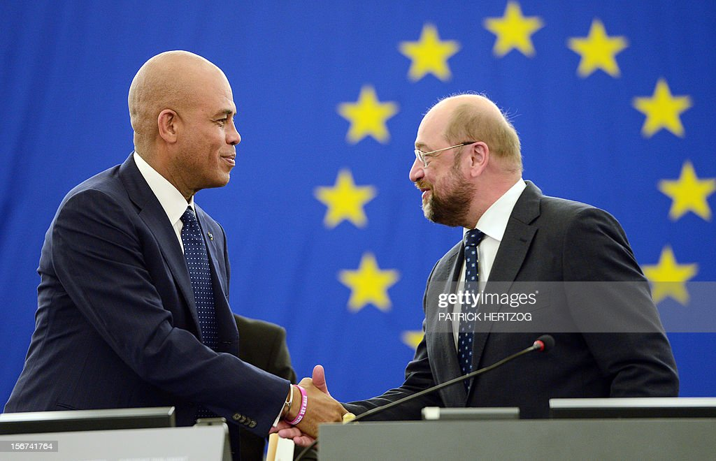 President of Haiti Michel Martelly (L) shakes hands with European Parliament president Martin Schulz (R) prior to address European MPs during a plenary session at the European Parliament, on November 20, 2012 in Strasbourg, eastern France.