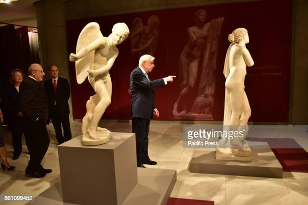 MUSEUM ATHENS ATTIKI GREECE President of Hellenic Republic Prokopis Pavlopoulos points a detail of a statue to the Professor Dimitrios Pantermalis...
