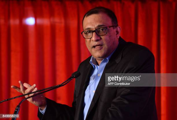 President of Honeywell in India Vikas Chadha speaks during the launch of a new range of airpurifiers in New Delhi on September 20 2017 / AFP PHOTO /...