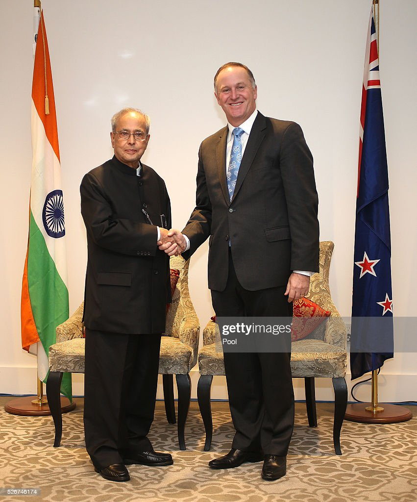 President of India Pranab Mukharjee and New Zealand Prime Minister <a gi-track='captionPersonalityLinkClicked' href=/galleries/search?phrase=John+Key&family=editorial&specificpeople=2246670 ng-click='$event.stopPropagation()'>John Key</a> shake hands during the the signing of the New Zealand-India Air Services Agreement at The Langham Hotel Auckland on May 1, 2016 in Auckland, New Zealand. Mukharjee is on a three-day visit to New Zealand.