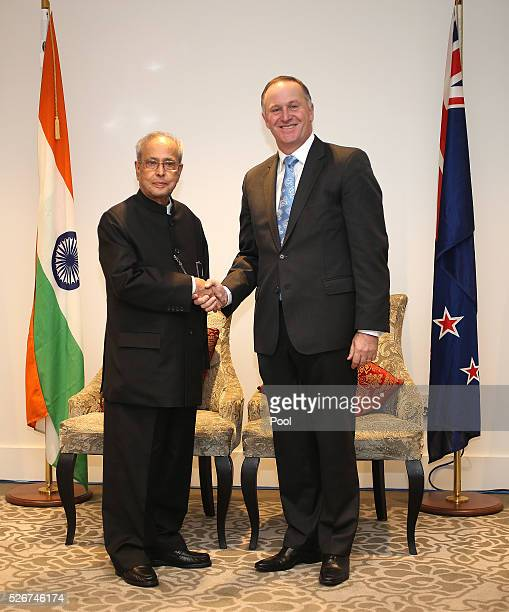 President of India Pranab Mukharjee and New Zealand Prime Minister John Key shake hands during the the signing of the New ZealandIndia Air Services...