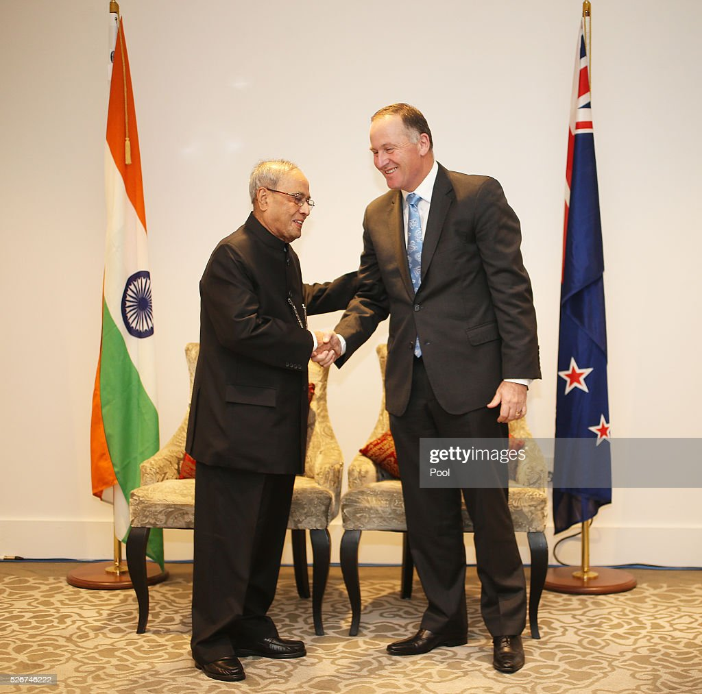 President of India Pranab Mukharjee and New Zealand Prime Minister John Key shake hands during the the signing of the New Zealand-India Air Services Agreement at The Langham Hotel Auckland on May 1, 2016 in Auckland, New Zealand. Mukharjee is on a three-day visit to New Zealand.