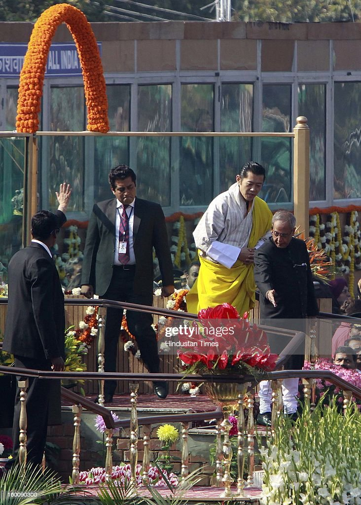 President of India Pranab Mukherjee leaves with chief guest King of Bhutan, Jigme Khesar Namgyel Wangchuck during the 64th Republic Day parade celebration at Raj path on January 26, 2013 in New Delhi, India. India marked its Republic Day with celebrations held under heavy security, especially in New Delhi where large areas were sealed off for an annual parade of military hardware.