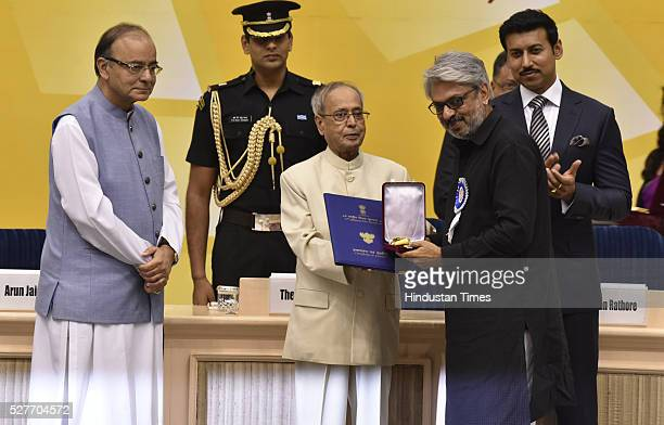 President of India Pranab Mukherjee presenting Best Director award to Sanjay Leela Bhansali for Bajirao Mastani during the 63rd National Film Awards...