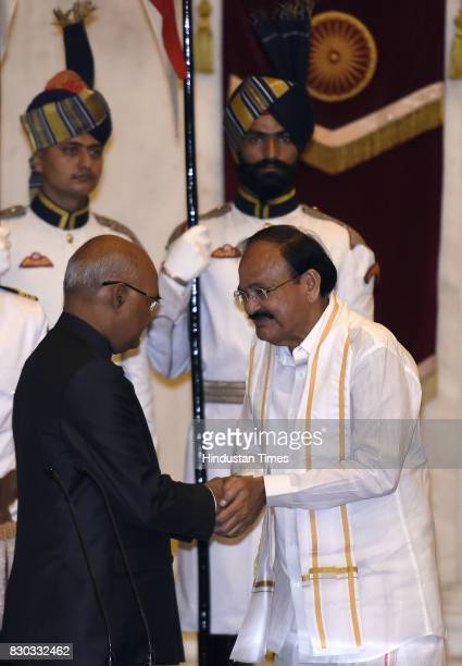 President of India Ram Nath Kovind administering the oath to M Venkaiah Naidu as the 13th VicePresident of India during the at Darbar Hall...