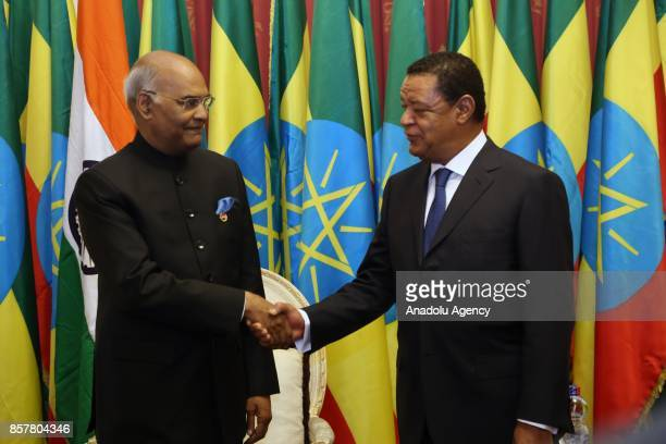 President of India Ram Nath Kovind and President of Ethiopia Mulatu Teshome Wirtu shake hands as they pose for a photo during their meeting at...