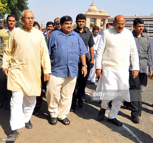 President of India's Bharatiya Janata Party Nitin Gadkari walks with officials as he visits Rashtriya Swayamsevak Sangh Headquarters in Mumbai on...
