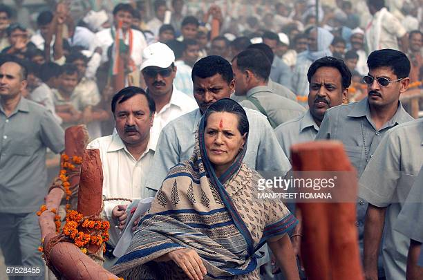 President of India's ruling Congress Party and Chairperson of the United Progressive Alliance Government Sonia Gandhi greets her supporters during a...