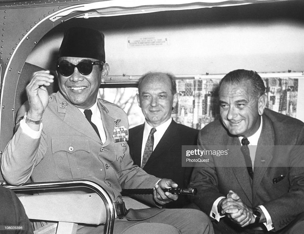 President of Indonesia <a gi-track='captionPersonalityLinkClicked' href=/galleries/search?phrase=Sukarno&family=editorial&specificpeople=209275 ng-click='$event.stopPropagation()'>Sukarno</a> (sometimes known as Achmed <a gi-track='captionPersonalityLinkClicked' href=/galleries/search?phrase=Sukarno&family=editorial&specificpeople=209275 ng-click='$event.stopPropagation()'>Sukarno</a>, 1901 - 1970) smiles as he sits in a helicopter with US Secretary of State <a gi-track='captionPersonalityLinkClicked' href=/galleries/search?phrase=Dean+Rusk&family=editorial&specificpeople=93282 ng-click='$event.stopPropagation()'>Dean Rusk</a> (1909 - 1994) and Vice President <a gi-track='captionPersonalityLinkClicked' href=/galleries/search?phrase=Lyndon+Johnson&family=editorial&specificpeople=91450 ng-click='$event.stopPropagation()'>Lyndon Johnson</a> (1908 - 1973) following meetings with the President, Washington DC, April 25, 1961. Abbie Rowe Photographer.