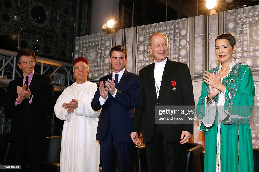 President of Institut du Monde Arabe, Jack Lang, Minister of Endowments and Islamic Affairs of Morocco Ahmed Toufiq, French Prime Minister Manuel Valls, Bishop of Evry, awarded Michel Dubost and HRH The Princess Lalla Meryem of Morocco who delivers the insignia of the Order of the Throne. Held at Institut du Monde Arabe on February 1, 2015 in Paris, France.