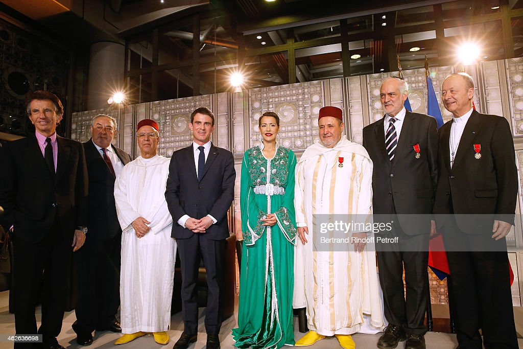 President of Institut du Monde Arabe, Jack Lang, Secretary General of the Jewish Communities of Morocco, Serge Berdugo, Minister of Endowments and Islamic Affairs of Morocco Ahmed Toufiq, French Prime Minister Manuel Valls, HRH The Princess Lalla Meryem of Morocco, Rector of the Mosque of Evry, awarded Khalil Merroun, Rabbi of Ris Orangis, awarded Michel Serfaty and Bishop of Evry, awarded Michel Dubost attend HRH The Princess Lalla Meryem of Morocco delivers the insignia of the Order of the Throne. Held at Institut du Monde Arabe on February 1, 2015 in Paris, France.