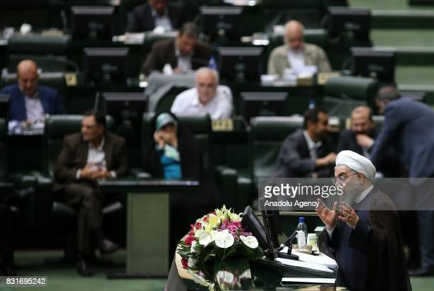 President of Iran Hassan Rouhani delivers a speech during a vote of confidence session held for 12th term ministers at the Iranian parliament in...