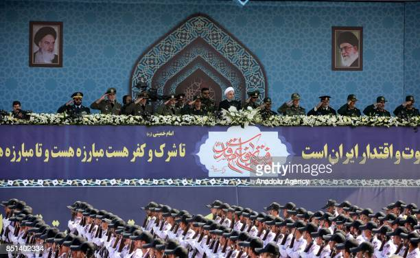President of Iran Hassan Rouhani delivers a speech in front of former Supreme Leader of Iran Ali Khamenei's shrine due to the Sacred Defence Week in...