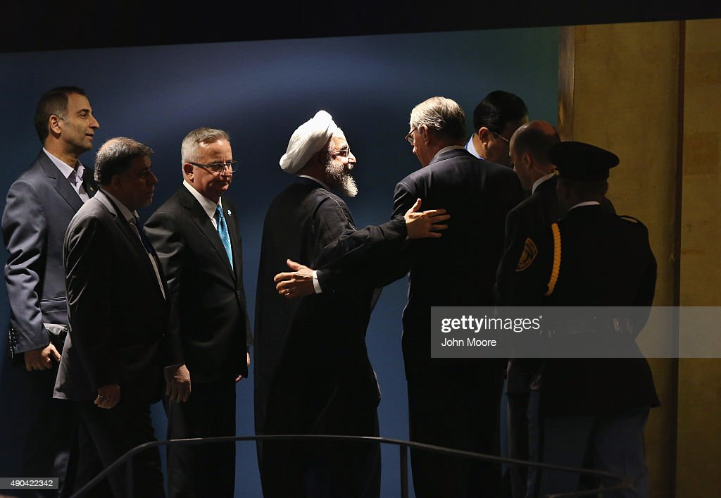 President of Iran <a gi-track='captionPersonalityLinkClicked' href=/galleries/search?phrase=Hassan+Rouhani+-+Homme+politique&family=editorial&specificpeople=641593 ng-click='$event.stopPropagation()'>Hassan Rouhani</a> (4th L) embraces United Nations Deputy Secretary General <a gi-track='captionPersonalityLinkClicked' href=/galleries/search?phrase=Jan+Eliasson&family=editorial&specificpeople=563205 ng-click='$event.stopPropagation()'>Jan Eliasson</a> (4th R) after Rouhani addressed the UN General Assembly on September 28, 2015 in New York City. World leaders gathered for the 70th session of the annual meeting.