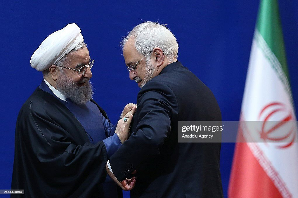 President of Iran Hassan Rouhani (L) gives meritorious service medal to Mohammad Javad Zarif Iranian Minister of Foreign Affairs in Tehran, Iran on February 8, 2016.