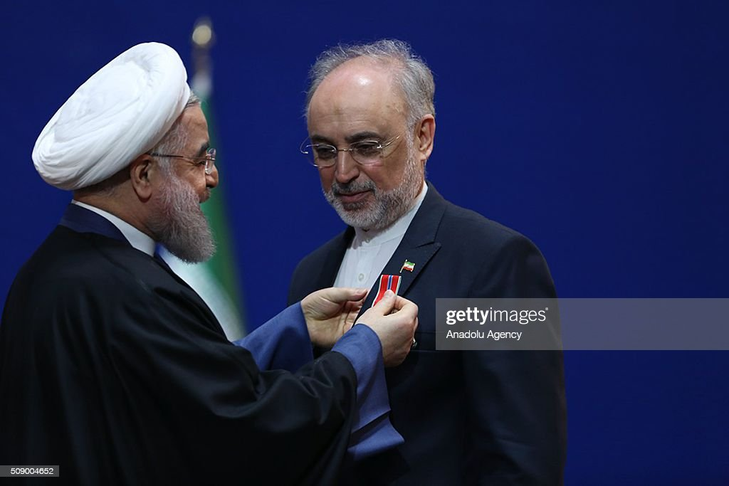 President of Iran Hassan Rouhani (L) gives meritorious service medal to Ali Akbar Salehi, Head of Atomic Energy Organization in Tehran, Iran on February 8, 2016.