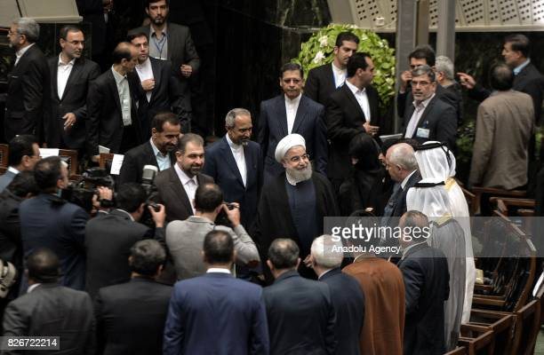 President of Iran Hassan Rouhani greets officials after his swearing in ceremony for his second term of presidency at the Iranian parliament in...