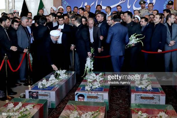 President of Iran Hassan Rouhani lays flower during the funeral ceremony of victims who died in bombings of Iran's parliament and the Mausoleum of...