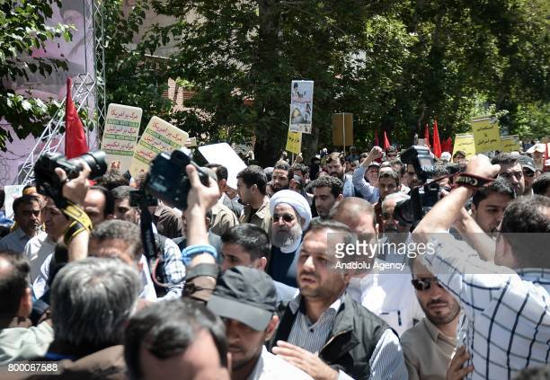 President of Iran Hassan Rouhani participates in a march marking the Jerusalem Day in Tehran Iran on June 23 2017