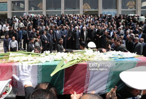 President of Iran Hassan Rouhani Speaker of the Parliament of Iran Ali Larijani and Chief Justice of Iran Sadeq Larijani attend the funeral ceremony...