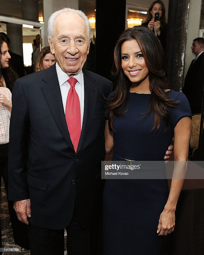 President of Israel Shimon Peres and actress <a gi-track='captionPersonalityLinkClicked' href=/galleries/search?phrase=Eva+Longoria&family=editorial&specificpeople=202082 ng-click='$event.stopPropagation()'>Eva Longoria</a> pose for a photo during his visit to address Latino and Jewish leaders held at the Beverly Hilton Hotel on March 11, 2012 in Los Angeles, California.