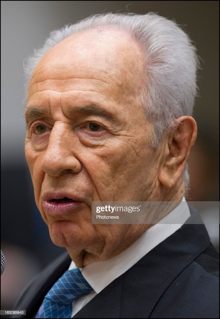 President of Israel <a gi-track='captionPersonalityLinkClicked' href=/galleries/search?phrase=Shimon+Peres&family=editorial&specificpeople=201775 ng-click='$event.stopPropagation()'>Shimon Peres</a> during a ceremony to award Belgian families with the Righteous Among the Nations for saving Jewish citizens on March 5, 2013 in Brussels , Belgium. 11 Belgian families were decorated with the Righteous Among the Nations for saving Jewish citizens during World War II.