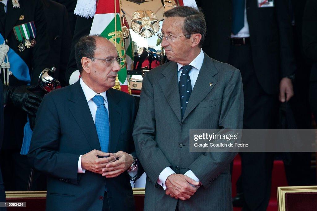 President of Italian Senate, <a gi-track='captionPersonalityLinkClicked' href=/galleries/search?phrase=Renato+Schifani&family=editorial&specificpeople=4851265 ng-click='$event.stopPropagation()'>Renato Schifani</a> (L) and President of the Chamber of Deputy, <a gi-track='captionPersonalityLinkClicked' href=/galleries/search?phrase=Gianfranco+Fini&family=editorial&specificpeople=228973 ng-click='$event.stopPropagation()'>Gianfranco Fini</a> talk as they attend a military parade at Via dei Fori Imperiali to mark the founding of the Italian Republic on June 2, 2012 in Rome, Italy. The Italian Republic was founded in 1946, after the death of Benito Mussolini.