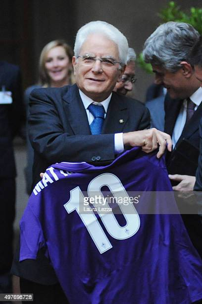 President of Italy Sergio Mattarella shows the Fiorentina Football Club shirt after receiving the title of 'Accademico della Crusca' at Accademia...