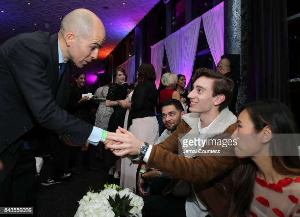 President of IWC Schaffhausen Edouard d' Arbaumont congratulates TIFF Rising Star Theodore Pellerin during the 2017 Toronto International Film...