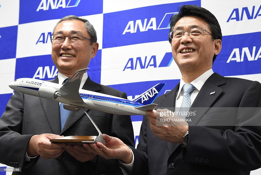 President of Japan's ANA Holdings <a gi-track='captionPersonalityLinkClicked' href=/galleries/search?phrase=Shinichiro+Ito&family=editorial&specificpeople=5666038 ng-click='$event.stopPropagation()'>Shinichiro Ito</a> (L) and Vice President Shinya Katanozaka (R) pose for photographers during a press conference at the headquarters in Tokyo on February 13, 2015. All Nippon Airways (ANA) announced on February 13 Katanozaka will be promoted to president of Japan's biggest airline on April 1. AFP PHOTO / Toru YAMANAKA