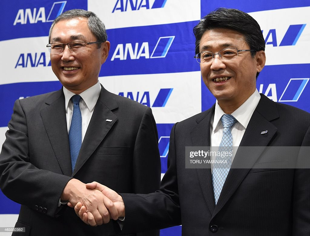 President of Japan's ANA Holdings <a gi-track='captionPersonalityLinkClicked' href=/galleries/search?phrase=Shinichiro+Ito&family=editorial&specificpeople=5666038 ng-click='$event.stopPropagation()'>Shinichiro Ito</a> (L) shakes hands with Vice President Shinya Katanozaka (R) as they pose for photographers during a press conference at the headquarters in Tokyo on February 13, 2015. All Nippon Airways (ANA) announced on February 13 Katanozaka will be promoted to president of Japan's biggest airline on April 1. AFP PHOTO / Toru YAMANAKA
