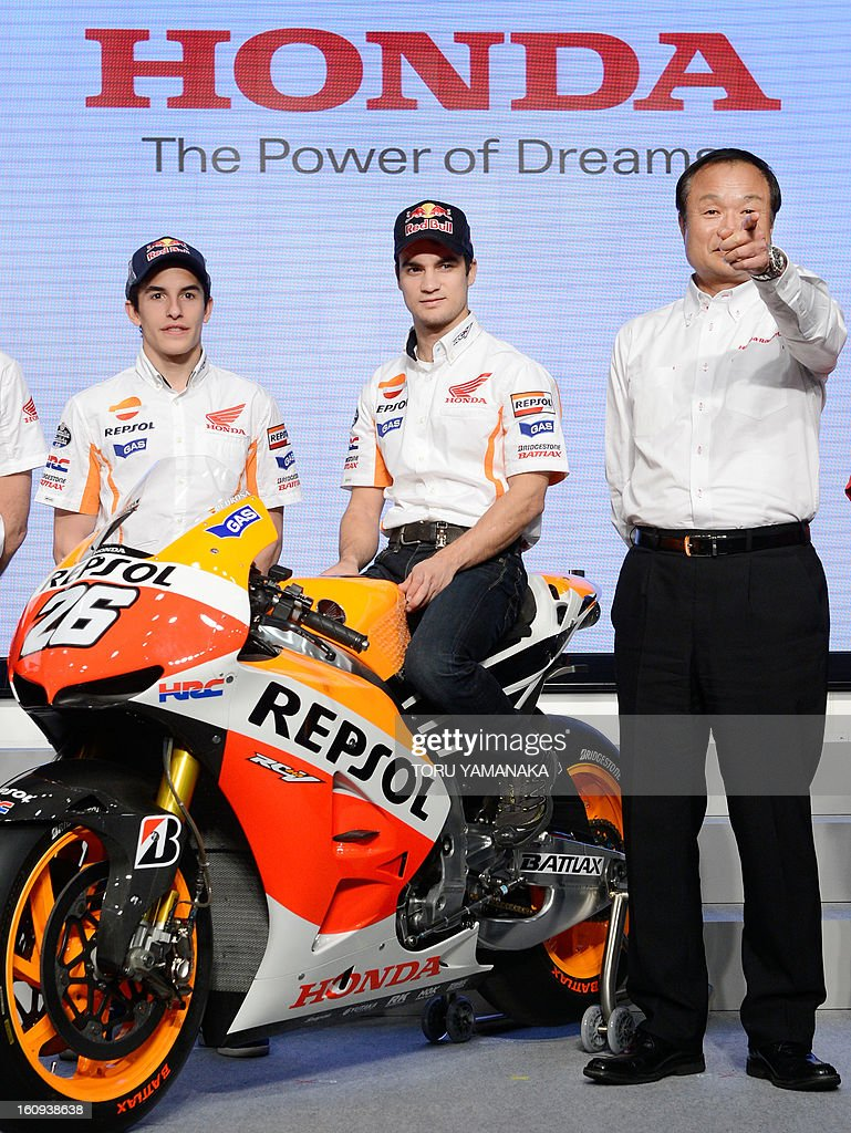 President of Japan's auto maker Honda Motor Takanobu Ito (R) introduces its MotoGP Spanish riders Dani Pedrosa (C) and Marc Marquez (L) during a press conference to announce its 2013 motor sports activities at the Honda headquarters in Tokyo on February 8, 2013. AFP PHOTO/Toru YAMANAKA
