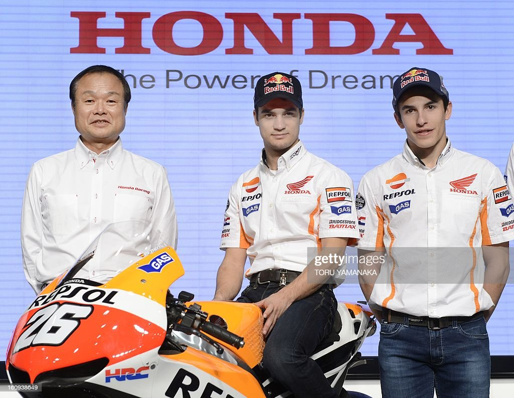 President of Japan's auto maker Honda Motor Takanobu Ito (L) introduces its MotoGP Spanish riders Dani Pedrosa (C) and Marc Marquez (R) during a press conference to announce Honda's 2013 motor sports activities, at the company's headquarters in Tokyo on February 8, 2013. AFP PHOTO/Toru YAMANAKA