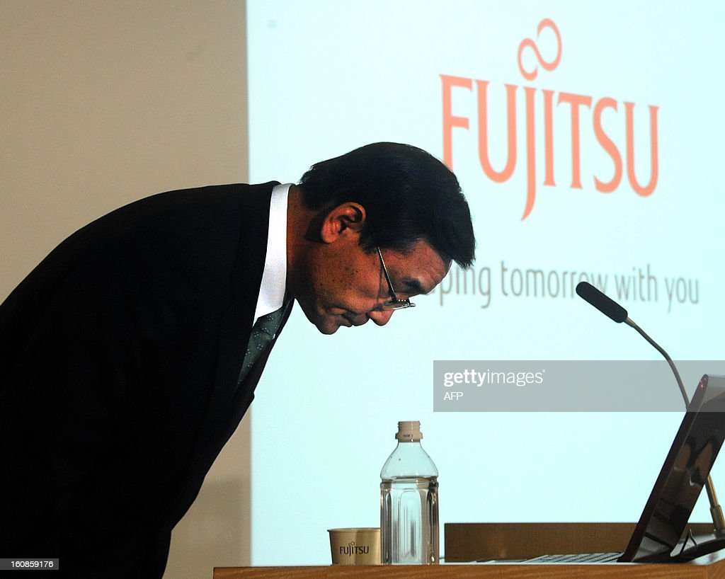 President of Japan's computer maker Fujitsu, Masami Yamamoto bows as the company announces its third quarter financial results ending December at the company's headquarters in Tokyo on February 7, 2013. Japan's Fujitsu said it plunged into a loss nearing 1.0 billion USD in the nine months to December, mainly on special charges, as it eyes chopping 9,500 jobs from its payroll worldwide.