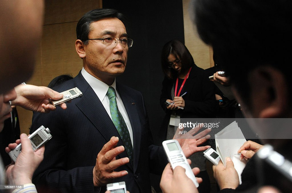 President of Japan's computer maker Fujitsu, Masami Yamamoto, is surrounded by the media after announcing the company's third quarter financial results ending December at the company's headquarters in Tokyo on February 7, 2013. Japan's Fujitsu said it plunged into a loss nearing 1.0 billion USD in the nine months to December, mainly on special charges, as it eyes chopping 9,500 jobs from its payroll worldwide.