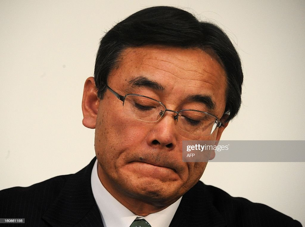 President of Japan's computer maker Fujitsu, Masami Yamamoto reacts as he announces the company's third quarter financial results ending December at the company's headquarters in Tokyo on February 7, 2013. Japan's Fujitsu said it plunged into a loss nearing 1.0 billion USD in the nine months to December, mainly on special charges, as it eyes chopping 9,500 jobs from its payroll worldwide.