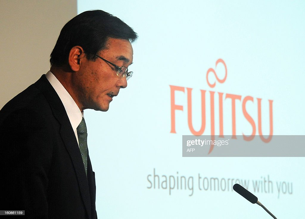 President of Japan's computer maker Fujitsu, Masami Yamamoto speaks as the company announces its third quarter financial results ending December at the company's headquarters in Tokyo on February 7, 2013. Japan's Fujitsu said it plunged into a loss nearing 1.0 billion USD in the nine months to December, mainly on special charges, as it eyes chopping 9,500 jobs from its payroll worldwide.
