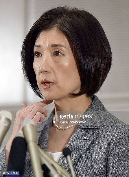 President of Japan's Otsuka Kagu furniture chain Kumiko Otsuka gestures as she answers questions during a press conference after its annual...