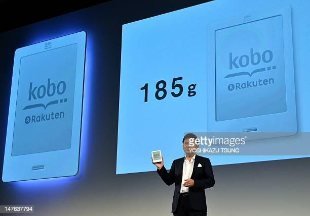 President of Japan's top online retailer Rakuten Hiroshi Mikitani introduces the company's electronic book player 'Kobo Touch' in Tokyo on July 2...