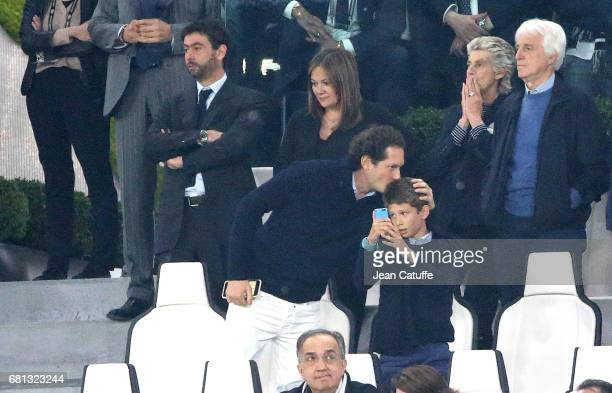 President of Juventus Andrea Agnelli and Deniz Akalin below Chairman of Fiat John Elkann during the UEFA Champions League semi final second leg match...