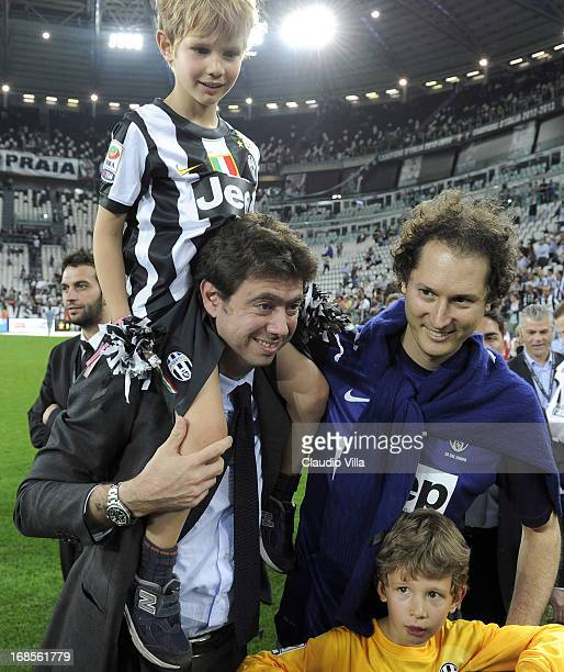 President of Juventus FC Andrea Agnelli and John Elkann celebrate with the Serie A trophy after the Serie A match between Juventus and Cagliari...