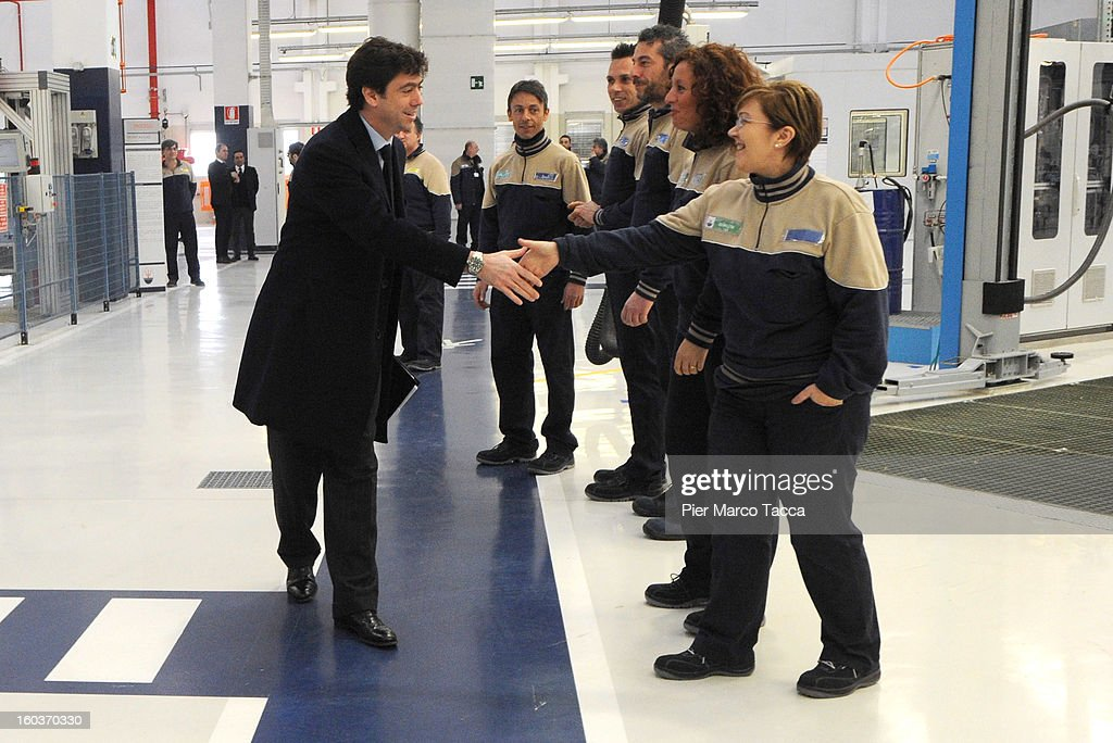 President of Juventus FC, Andrea Agnelli shakes hands with workers during the unveiling of the new Maserati plant in Grugliasco, which has been dedicated to Gianni Agnelli on January 30, 2013 in Turin, Italy. The new plant near the company's headquarters in Turin will produce Maserati's new model of luxury saloon cars, the Quattroporte.
