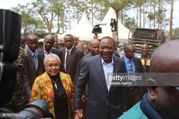 President of Kenya Uhuru Kenyatta and his wife Margaret Kenyatta arrive to cast their votes during the general elections at the Mutomo Primary School...