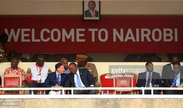 President of Kenya Uhuru Kenyatta speaks with President of the IAAF Lord Sebastian Coe during the opening ceremony on day one of the IAAF U18 World...
