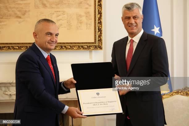 President of Kosovo Hashim Thaci presents the order of Kosovo to President of Albania Ilir Meta due to his contribution to Kosovo's independence in...