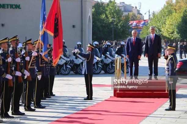 President of Kosovo Hashim Thaci welcomes President of Albania Ilir Meta during an official ceremony in Pristina Kosovo on October 11 2017