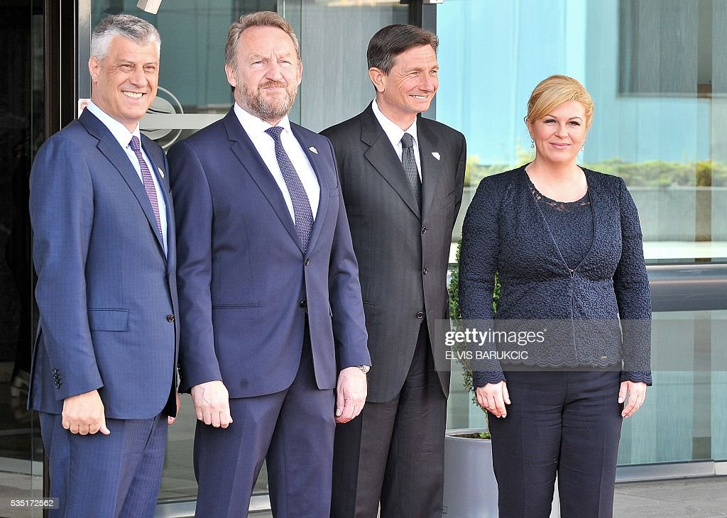 President of Kosovo Hasim Thaci, Member of the Tripartite Bosnian Presidency Bakir Izetbegovic, President of Slovenia Borut Pahor, Croatian President Kolinda Grabar-Kitarovic pose at Bosnia and Herzegovina's National Assembly in Sarajevo, on May 29, 2016. Heads of western Balkan nations meet for an annual summit during which they will discuss regional cooperation. / AFP / ELVIS