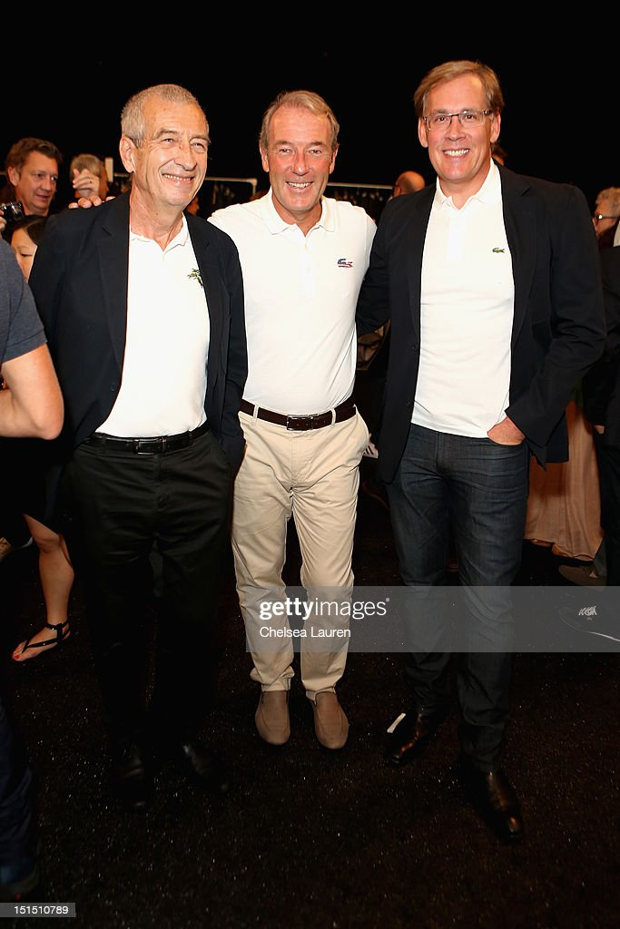 President of Lacoste Michel Lacoste, CEO of Lacoste Christophe Chenut and CEO of Lacoste USA Steve Birkhold pose backstage at the Lacoste Spring 2013 fashion show during Mercedes-Benz Fashion Week at The Theatre, Lincoln Center on September 8, 2012 in New York City.