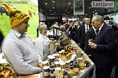 President of Latvia Andris Berzins looks at Latvian products during his visit of Latvia's exhibitors during the opening day of the 'Gruene Woche'...