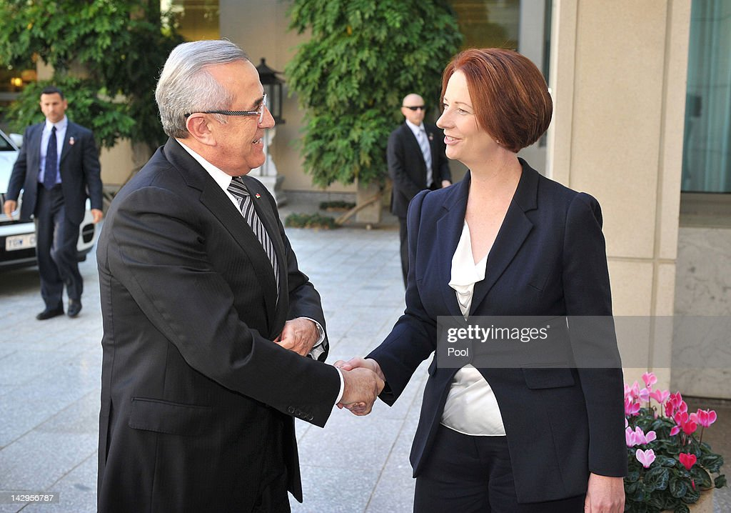 President of Lebanon <a gi-track='captionPersonalityLinkClicked' href=/galleries/search?phrase=Michel+Sleiman&family=editorial&specificpeople=2069358 ng-click='$event.stopPropagation()'>Michel Sleiman</a> is welcomed by Australian Prime Minister <a gi-track='captionPersonalityLinkClicked' href=/galleries/search?phrase=Julia+Gillard&family=editorial&specificpeople=787281 ng-click='$event.stopPropagation()'>Julia Gillard</a> to Parliament House on April 16, 2012 in Canberra, Australia. Suleiman is on a five-day state visit to Australia.